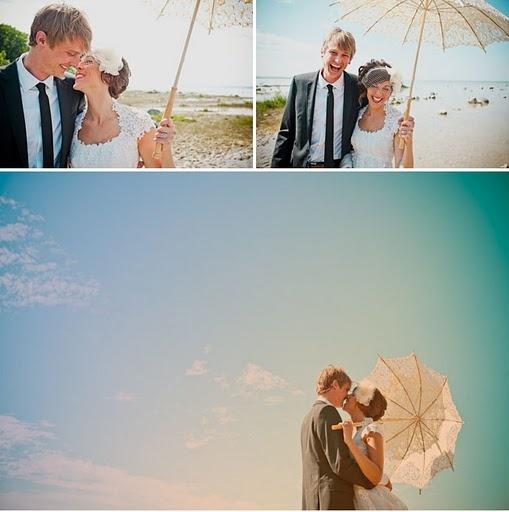 Bride and Groom on the beach underneath the umbrella