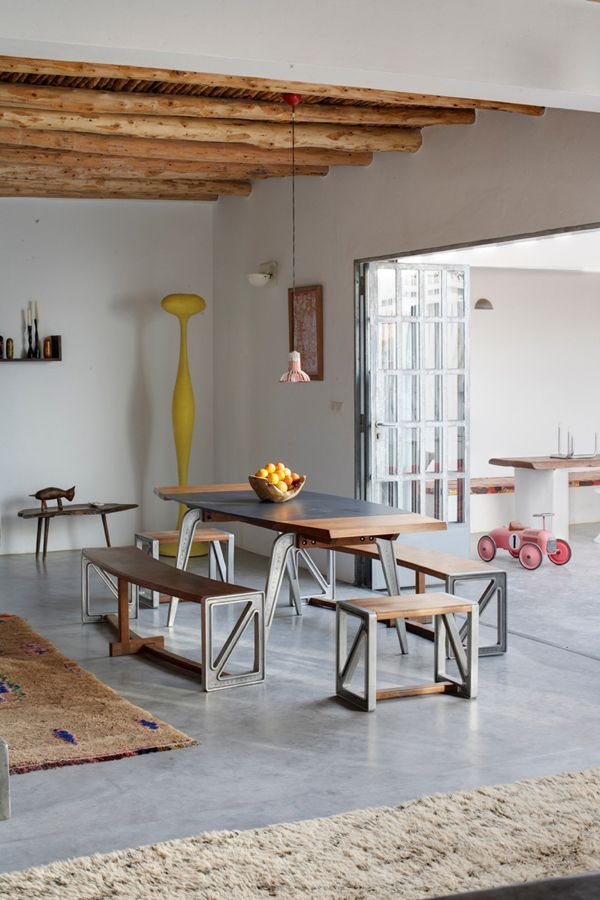 Love the industrial table and chairs with concrete floor