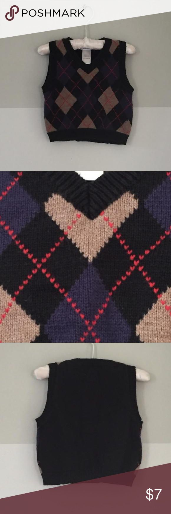 Janie and Jack Argyle Sweater Vest Black sweater vest with camel, dark purple, and red argyle pattern on front. V-neck. 100% cotton. Great for fall photos! Janie and Jack Shirts & Tops Sweaters