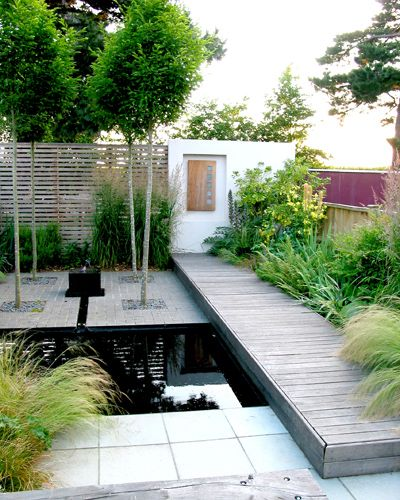 Contemporary garden design incorporating pond with more for Modern garden pond designs