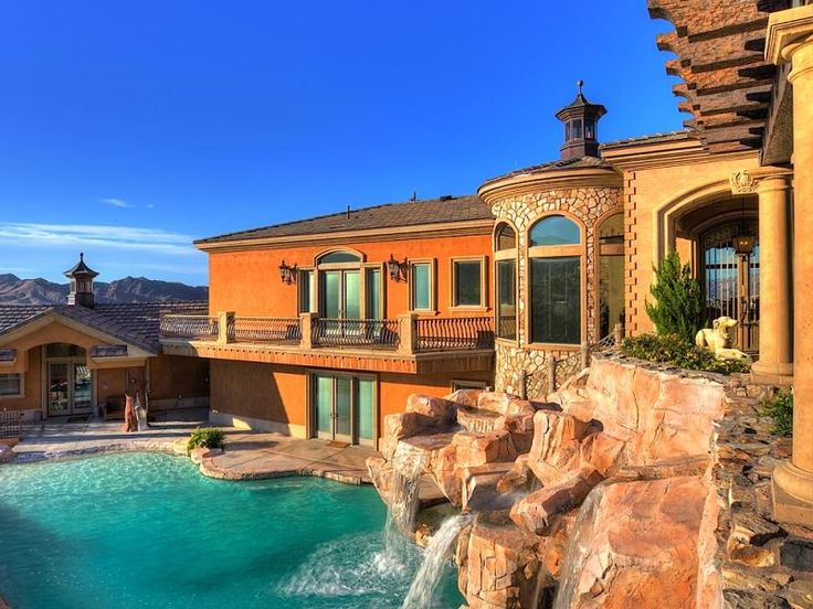 second story balcony overlooks the cascading waterfall and pool at this boulder city nevada home