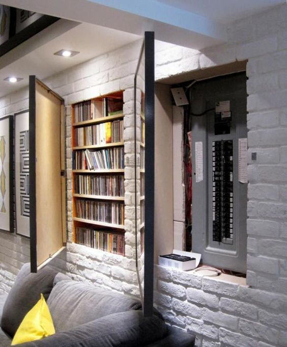 25 hidden fuse box and media storage in wall hidden by framed artwork - Shelterness