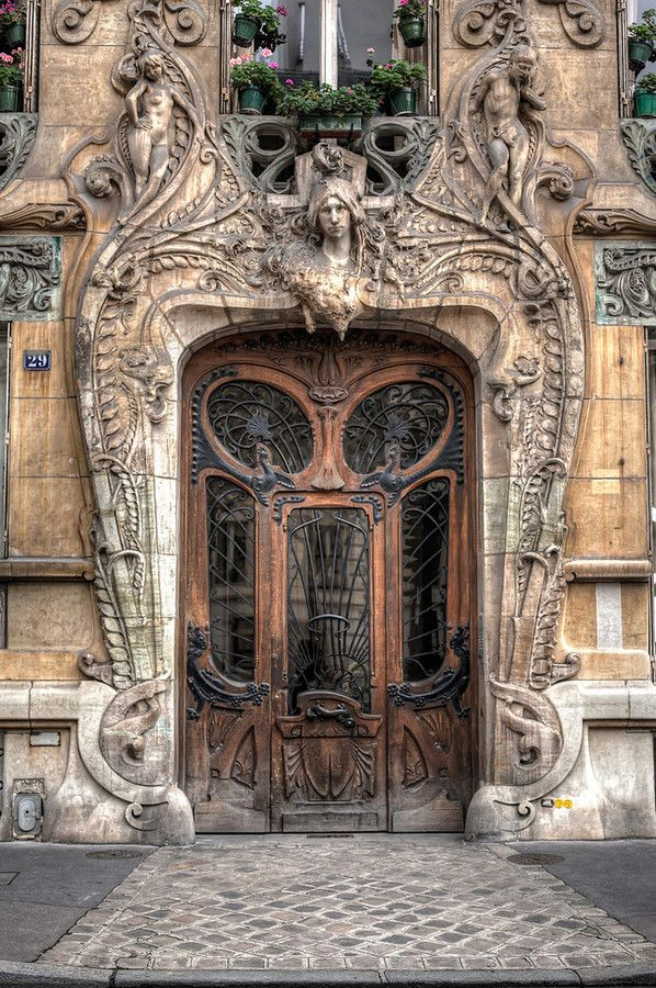 29 Avenue Rapp in the 7th arrondissement, very close to the Eiffel Tower. Built in 1901, this Art Nouveau masterpiece by Jules Lavirotte is quite striking. The detailed door was designed by sculptor Jean-Baptiste Larrive and sculpted by a variety of others.