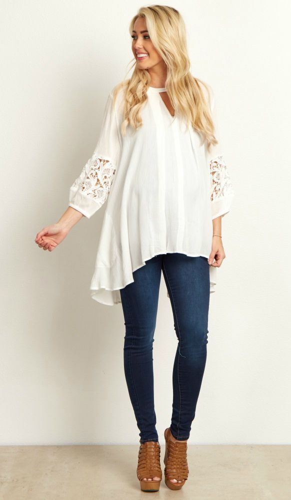 A beautiful flowy maternity tunic to easily accommodate your growing bump. A floral cutout detail with cinched sleeves makes for a bohemian look we absolutely love. Style this maternity tunic with maternity leggings and boots for a gorgeous ensemble. #maternityoutfits
