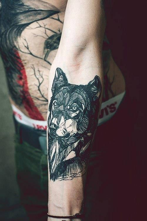 Geometric wolf tattoo Yeah I wanna see the other work on thus body.. looks like crows I love crows