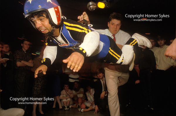 """Dwarf throwing competition """"Lenny the Giant"""" at a Croydon south London nightclub. England 1980s"""