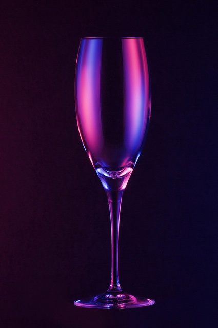 Coloured light on the product brings out the shape of the subject as well as contrast between the cup and the black background.