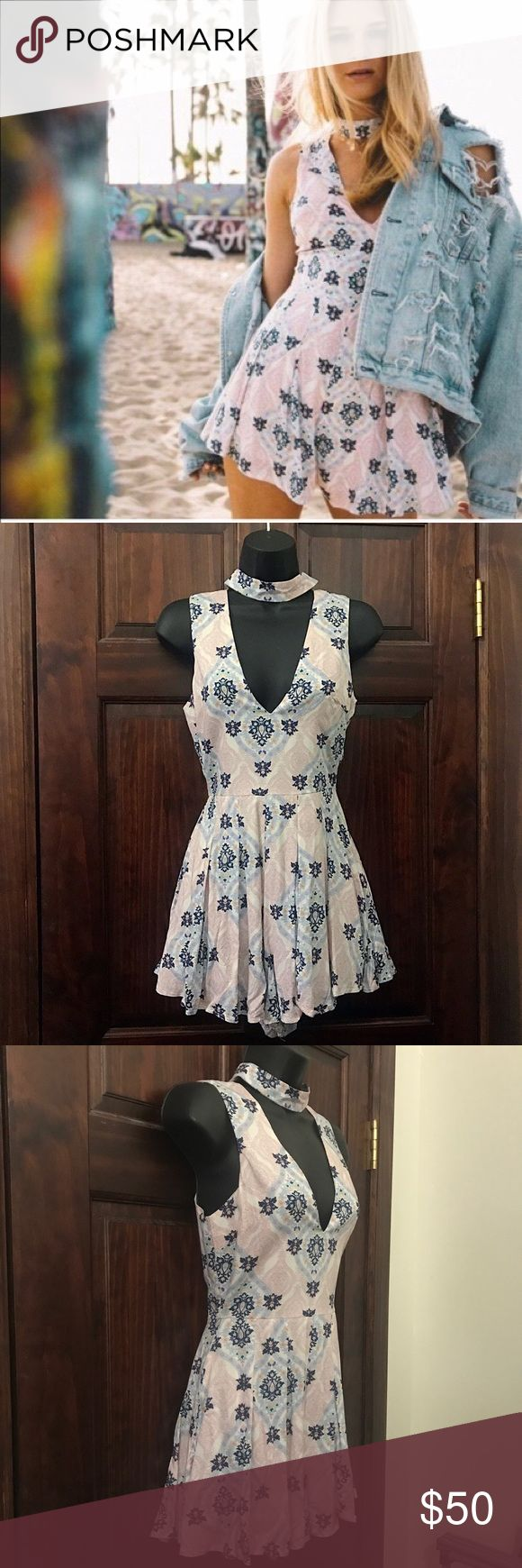 LF Floral Romper/Playsuit w/ Font Cut-Out & Choker NWT brand new via LF SoHo!! Moving & need to sell everything ASAP - please make offers & bundle your ❤️  out and the more lll try to discount things for you beyond my normal 15% off bundles of 2+ :) Pastel pink & blue floral design across white short romper with front cut out that both loooks & is sooo cute with any front design Style with a cute bra that has a strappy style on the front side to show off the look and either dress it up…