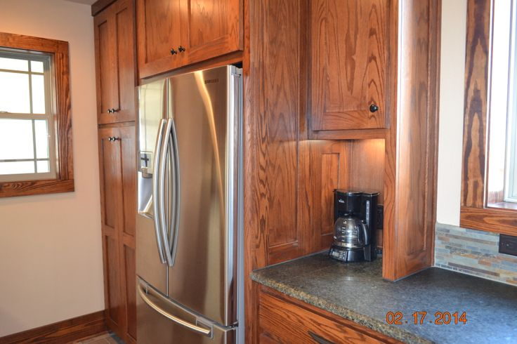 our L-shaped kitchen has this pantry and workspace hidden from view; it holds refrig, pantry to left, coffee bar to right, microwave and toaster oven on opposite wall with countertop workspace and tons of storage in here; plenty of room for several people to work in