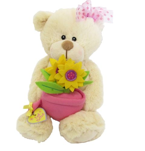 "A sweet soft teddy bear holding a pot with flowers on her knee. The little sign says ""Feel better"".    #sendateddy #teddybear #toy #gift"