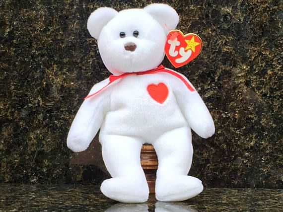 TY Beanie Baby, VALENTINO - 1993  Date of Birth: February 14, 1994  His heart is red and full of love He cares for you so give him a hug Keep him close when feeling blue Feel the love he has for you!  This Rare Bear is an awesome why to show somebody how much you love them!  Mint Condition Container-Stored Smoke-free environment Tag Protector (removed only for photos) P.E. Pellets (labeled on Tush Tag) Actual item shown