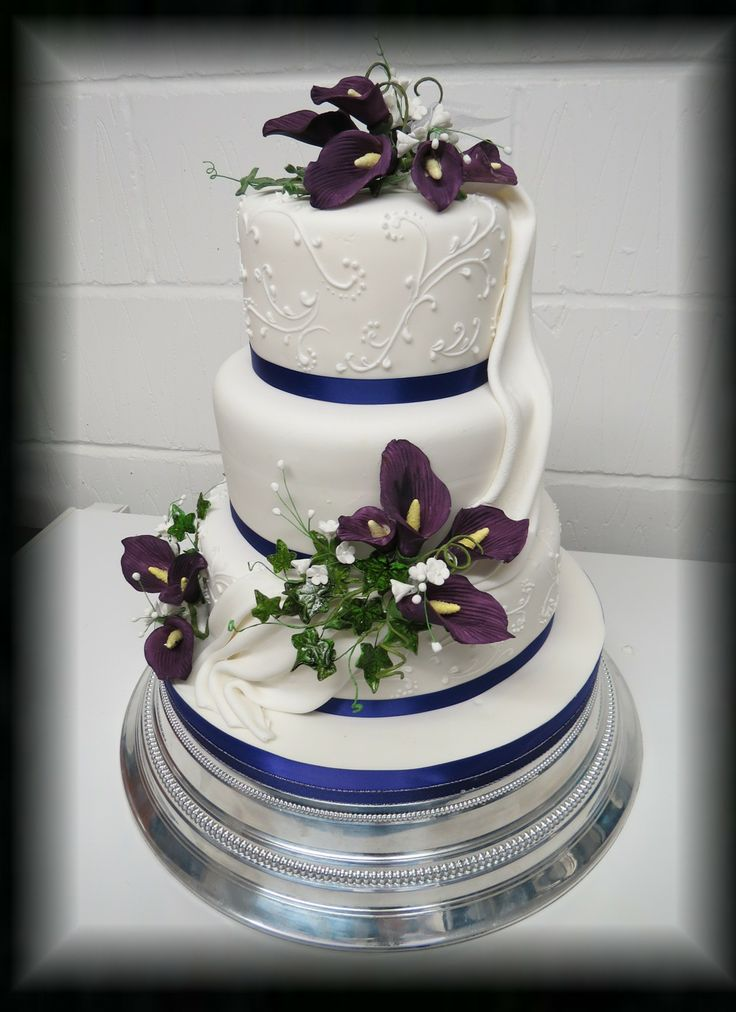 3 Tier wedding Cake with drape and sugar flowers