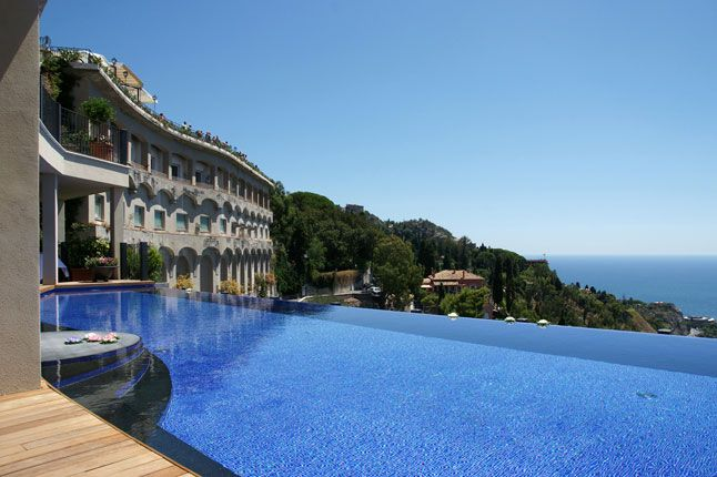 The clifftop infinity pool at the hotel Metropole Taormina, which overlooks the sea and Mount Etna in Sicily, and which reopened in 2011 wit...
