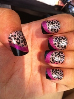 LOVE these cheetah print nails with some flare.