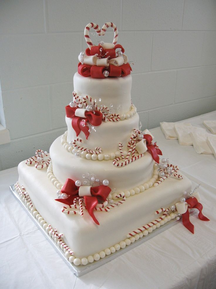 Christmas Candy Cane Wedding Cake -repinned from Southern California ceremony officiant https://OfficiantGuy.com