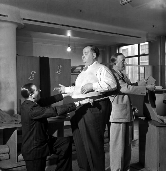 15th March 1947. American comedy duo Stan Laurel and Oliver Hardy the film comedians are pictured at menswear store in London's West End.