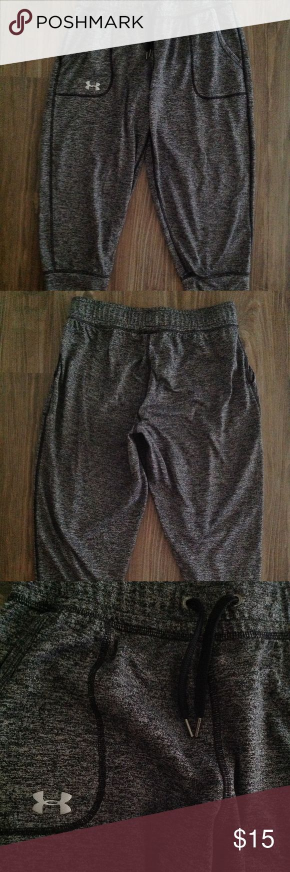 Under Armour Pants These heather grey soft pants are fabulous for multiple uses depending upon your style.  Comfy running, lifting, or simply lounging around.  Metal grommets and string ends.  EUC. Under Armour Pants Track Pants & Joggers