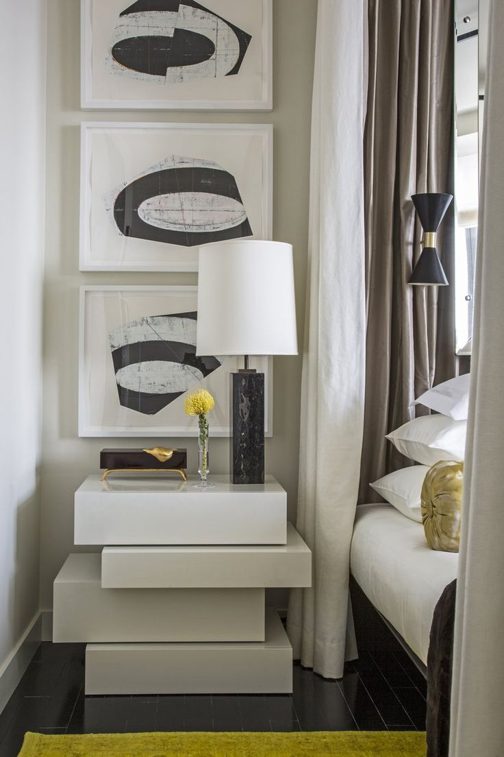 Nightstand design in white in a master bedroom design by Drake Anderson