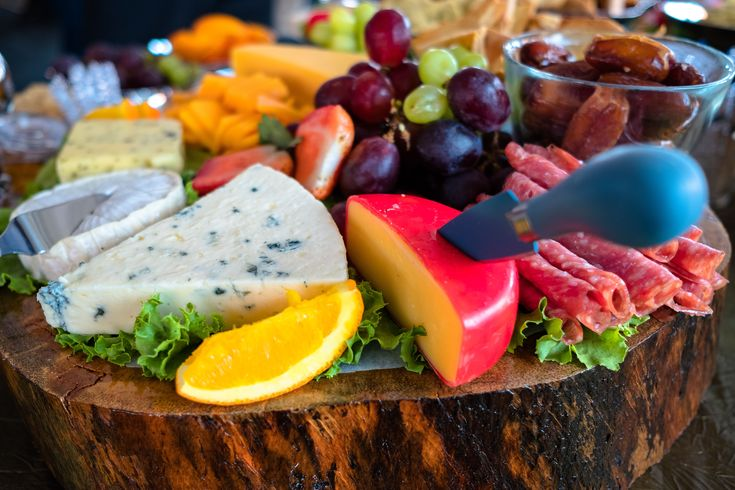 Corporate Events | Corporate Event Decor | Wooden Log | Wooden Log Decor | Cheese Variety | Blue Cheese | Ham | Grapes | Cheese Variety With Greenery ...