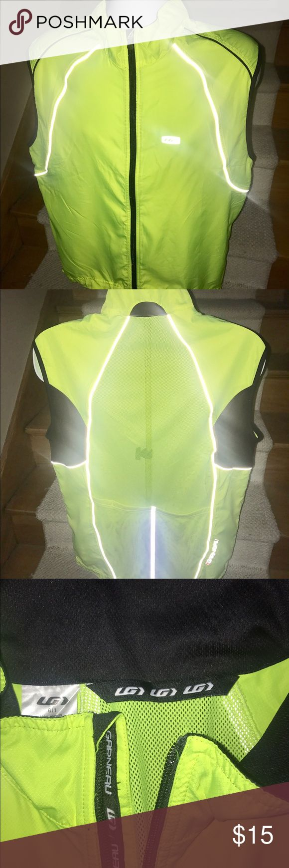 Louis Garneau bright men's cycling running vest XL Louis Garneau like new men's bright neon running cycling vest that is sized XL.  Pockets on the bottom of the back.  Reflective areas on front and back.  Great quality. Louis Garneau Jackets & Coats Vests