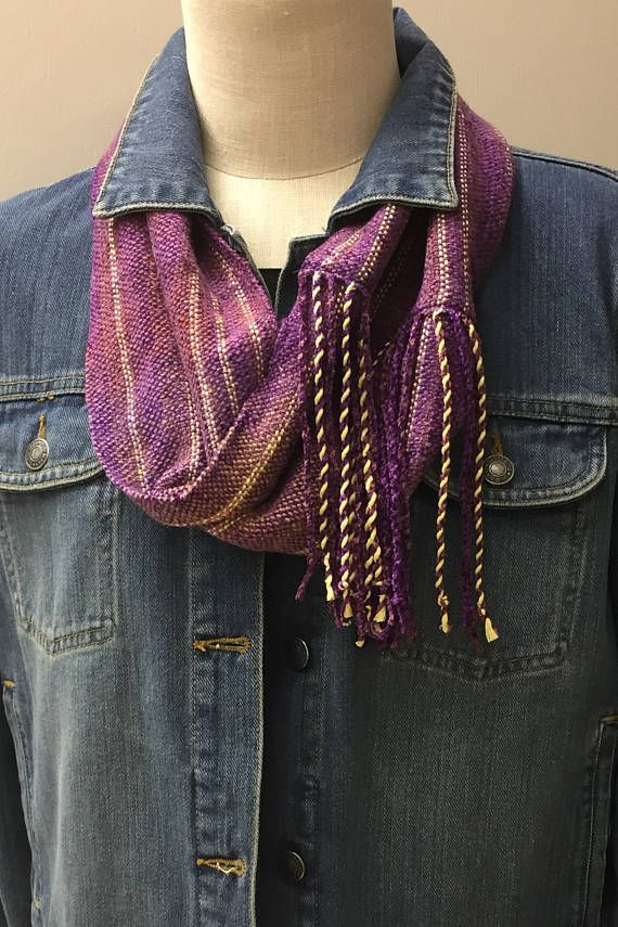 Hand Woven Mobius Cowl, in shades of purple and rust with a touch of gold. As you can see from the photos, this cowl goes from casual to dressy effortlessly. The colors in this Mobius drift from one shade to the next. It is soft, easy to wear and can be worn with almost anything. It would really dress up that ubiquitous little black dress or pop it on with a t-shirt and jeans. This would be a fabulous piece to add to your cruise wardrobe or just add a little sunshine to an outfit. The shape…