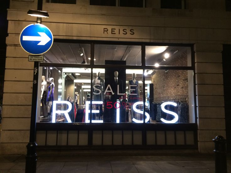 A window display of 'REISS' at the oxford circus in London.