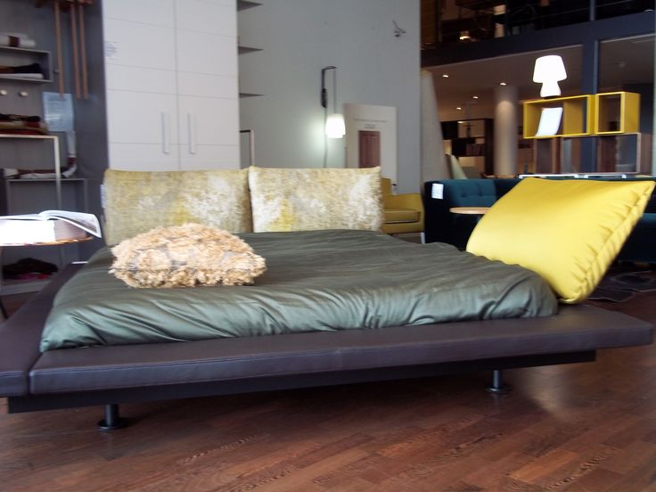The MALY 2 bed now in the City showroom. Shown in brown leather with gold cushions.
