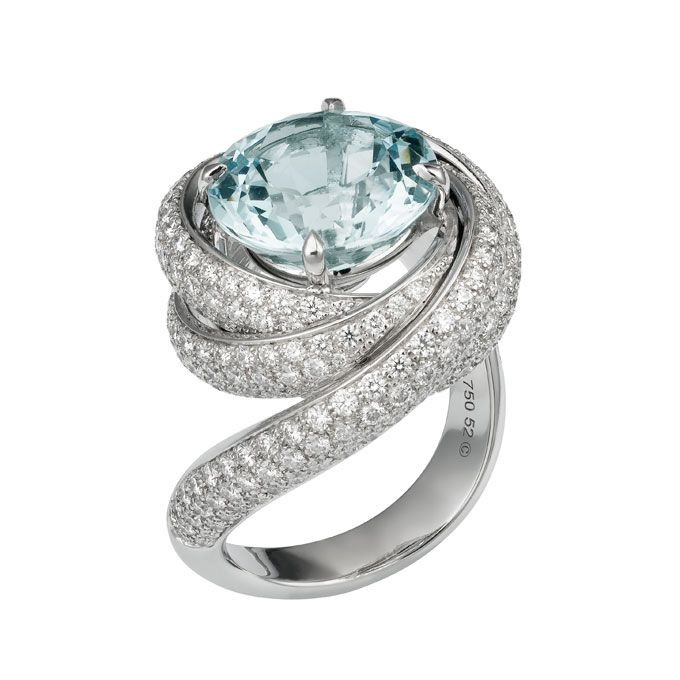 "Brides.com: Unique Engagement Ring Settings. ""Trinity de Cartier"" aquamarine and diamond 18K white gold engagement ring, price upon request, Cartier  See more Cartier engagement rings."