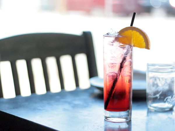 Simple favorite - Campari + Soda, over ice with an orange wedge. #SummerSips