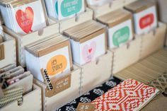 Find little boxes to place cards in then set them up in tiers.