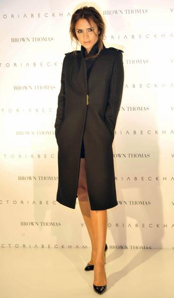 great coat! Victoria Beckham posing at Brown Thomas, Dublin's exclusive dept store