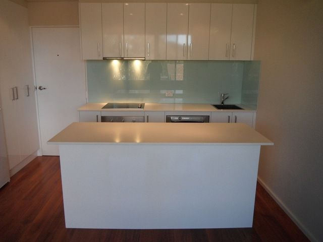 Small but sexy - this Contempo gloss white kitchen defines the space.  Available from Custom Flatpack, Queanbeyan, NSW www.customflatpack.com.au