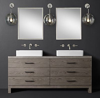 RH Modern's Meade Double Vessel Vanity - Wall Mount:Designed by Thomas Bina, the organic grain of oak provides a warm counterpoint to our Meade collection's clean 1970s postmodern design.