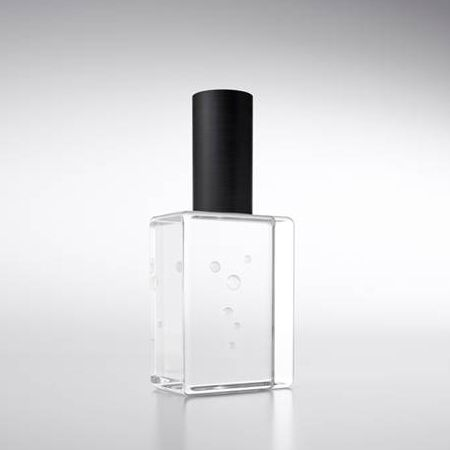Clear Perfume Bottle / seemingly empty bottle with an atomiser hidden in the cap while bubbles are trapped in the glass container