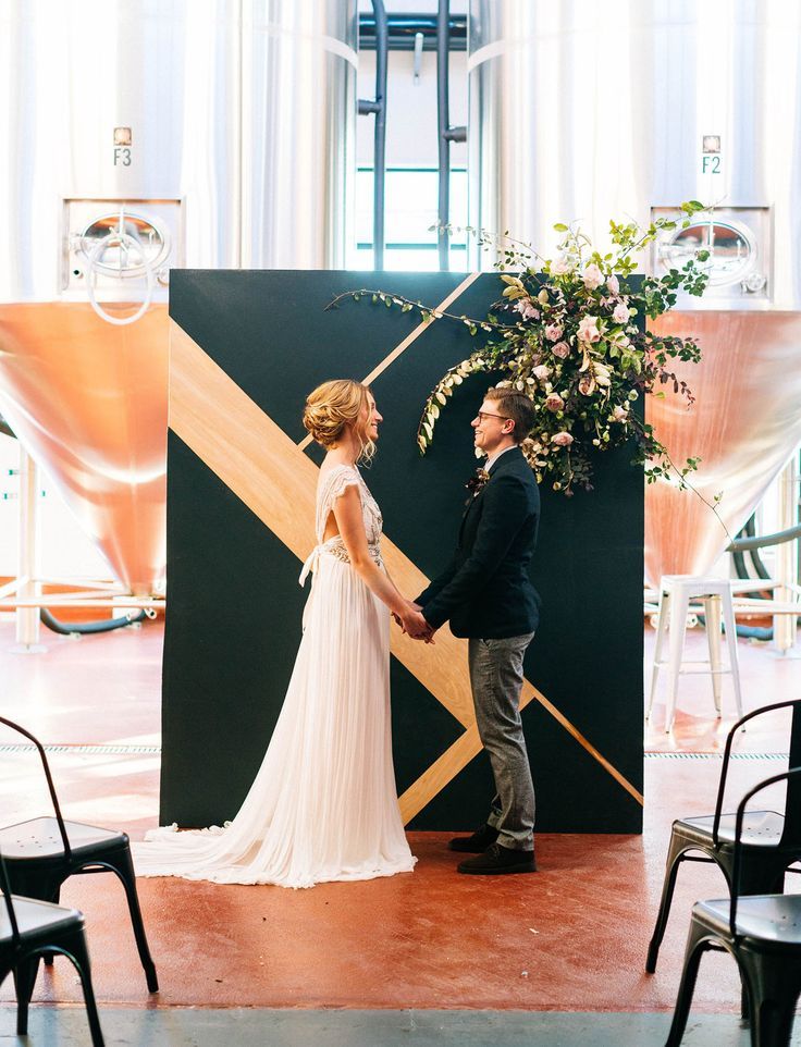modern wood backdrop for this industrial and romantic wedding in a brewery