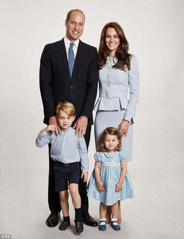 The Duke and Duchess of Cambridge with Prince George, four, and Princess Charlotte, two, in a family portrait taken earlier this year. The image appears on the family's Christmas card