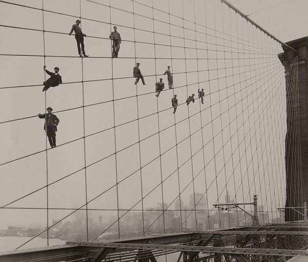 A brilliant time capsule of life in New York in the early 20th century captured by photographer Eugene de Salignac who shot this group of dapper looking bridge painters dangling on the  Brooklyn Bridge's suspension cables. Found on the Flickr stream for the Museum of Photographic Arts.