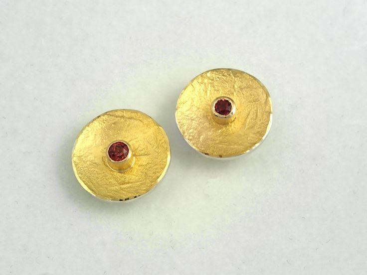 Classy gold and silver round earrings with a pink tourmaline stone and a rough…
