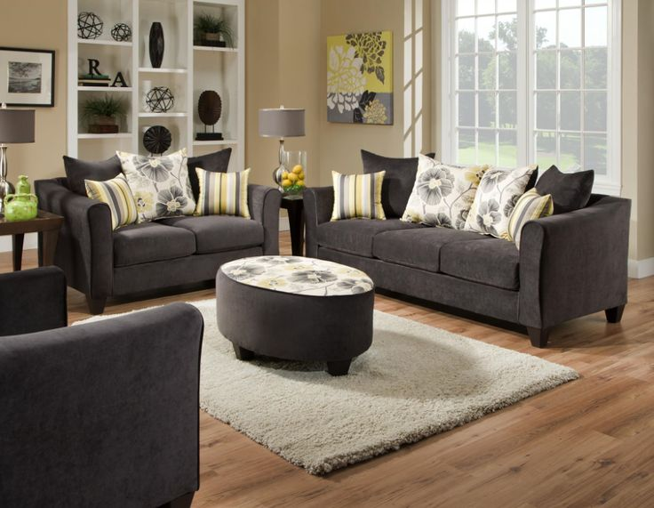 These classically chic charcoal sofa & loveseat set are covered in a smooth cotton fabric. The brightly colored accent pillows add a pop of color! Only $649.95!