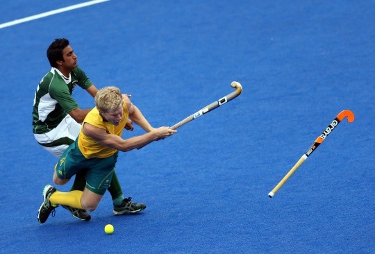 Matthew Butturini of Australia is fouled by Shafqat Easool of Pakistan during the Men's Hockey match between Australia and Pakistan on Day 11 of the London 2012 Olympic Games at Riverbank Arena Hockey Centre on Aug. 7, 2012.    Credit: Julian Finney/Getty Images