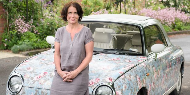 Paula Wallace, Design Director at Wallace Cotton with her Nissan Figaro. Auckland, New Zealand.