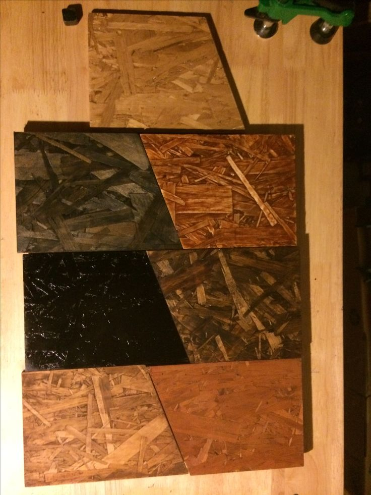 osb finishes.  neutral satin urethane, sanded vermont acorn stain with gloss uerethane, watco black walnut, flat vermont acorn stain, rodda walnut stain, black enamel, minwax ebony