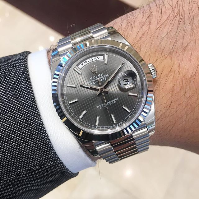 White Gold Rolex Day-Date 40 President with Stripe Motif Dial.