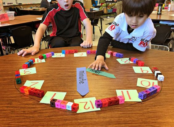 make a clock with sets of five pop cubes between each big number {broken link, but what a great idea!}
