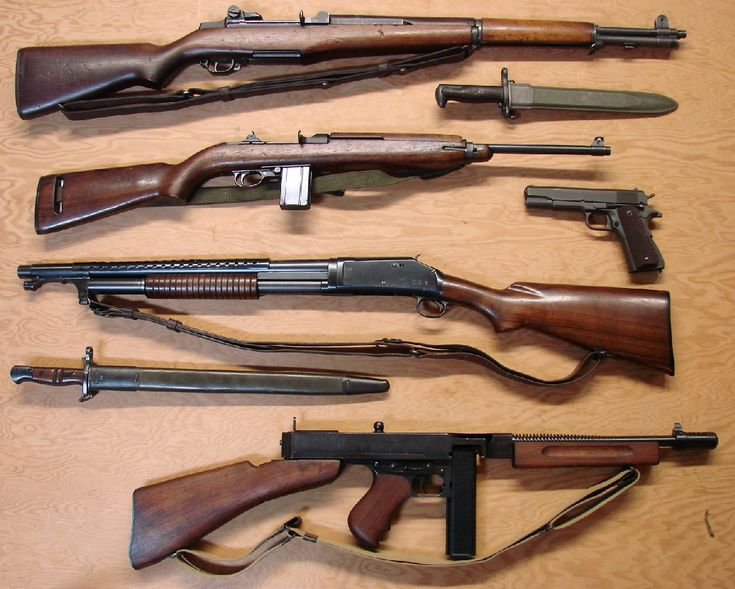 WWII collection: M1 Garand, M1 carbine, M1911, Winchester Model 1897, and Thompson submachine gun