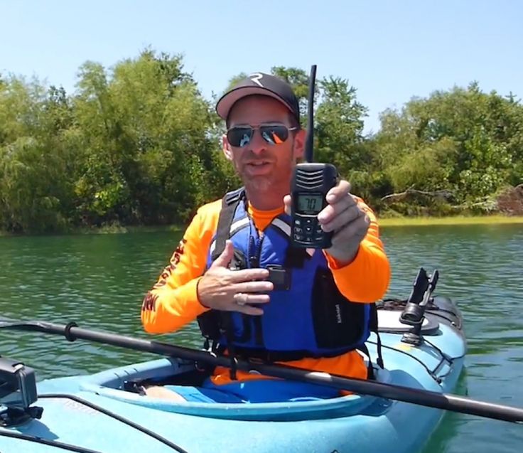 Jeff Herman holds up a VFH marine radio in a screenshot from his instructional video on how to use a marine radio.
