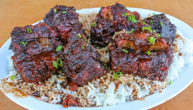 Beef Oxtail Recipe slow-smoked and cooked on the smoker with a rich braising liquid and great BBQ flavors.