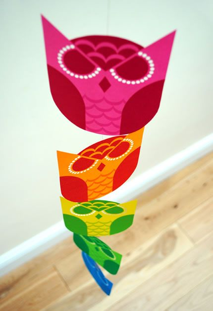 "Printable Rainbow Owl Mobile - I love how angry these owls look!    My mother-in-law made these for my baby shower and I've got them hanging above the changing table.  She added some glitter glue dots around the eyes and at the feathers and added some glittery eyes on some of the owls.  My son *loves* looking at them and ""talking"" to them when he's on the changer!"