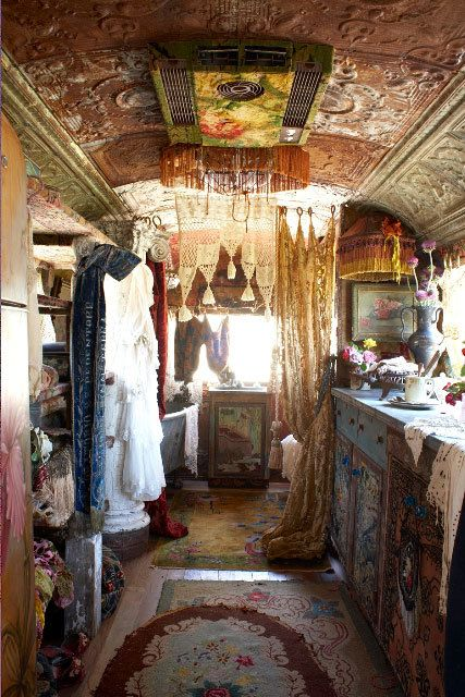 A closet in a Romany caravan-gypsy wagon: No need to pack, just take it all with you.