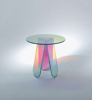 "#shimmer #patricia #urquiola Patricia Urquiola's poetically contemporary ""Shimmer"" table is brilliant in both its concept and physicality. Made from iridescent glass with a multicolored finish, the small tripodal table reacts with light, which allows its surface to seemingly change hue depending on your vantage point."